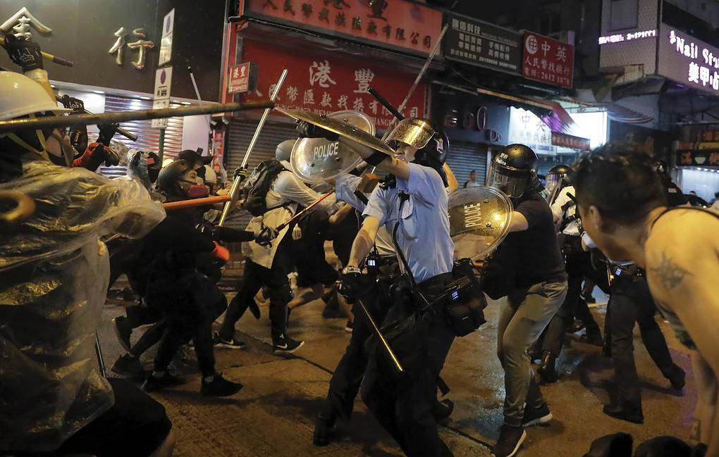 China rotates troops in Hong Kong as police ban new rally