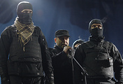 Right Sector leader Dmytro Yarosh (center) with guards