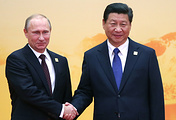 Russia's President Vladimir Putin (left) and China's President Xi Jinping (right)