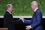 Russia's President Vladimir Putin (L) and FIFA President Gianni Infantino attend a gala concert of world opera stars held at Moscow's Bolshoi Theatre ahead of the 2018 FIFA World Cup Final match