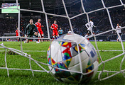 Russia's goalkeeper Andrei Lunev concedes a goal in a football friendly between the national men's football teams of Germany and Russia