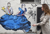 Graffiti by French artist Combo depicting France's President Emmanuel Macron and British Prime Minister Theresa May in Paris