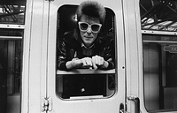 David Bowie leaning out of a railway carriage, 1973