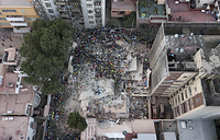 A magnitude 7.1 earthquake stunned central Mexico, killing more than 220 people as buildings collapsed in plumes of dust