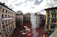 Several thousand people celebrate during the traditional firing of the 'chupinazo' that marks the beginning of the Festival of San Fermin at City Hall Square in downtown Pamplona, Spain