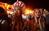 Russian fans anxiously watch the Russia vs Croatia quarterfinals match of the 2018 World Cup, Sochi, July 7
