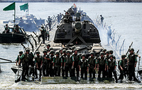 Russian soldiers on a pontoon raft during the Open Water contest between pontoon bridge units at the 2018 International Army Games on the Oka River