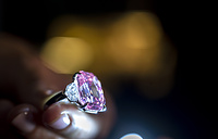A Christie's employee displays The Pink Legacy, a 18.96 carat Fancy Vivid Pink Diamond at the Christie's auction house in Geneva
