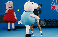 Serbia's Novak Djokovic with Peppa Pig characters at Kids Tennis Day, January 12