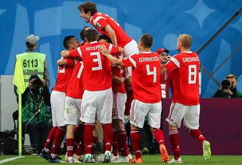 Russia's players celebrate scoring in the 2018 FIFA World Cup Group A Round 2 football match against Egypt at St Petersburg Stadium