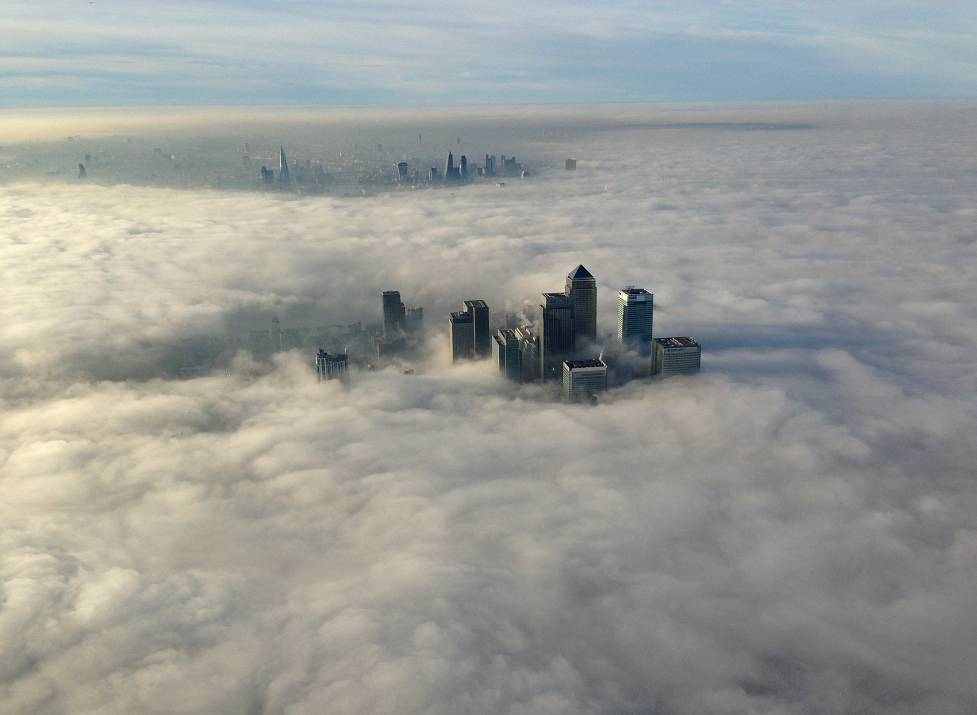 London skyscrapers piercing through the clouds. The shot was taken from a spec ops unit of the London Metropolitan police. December 12, 2013