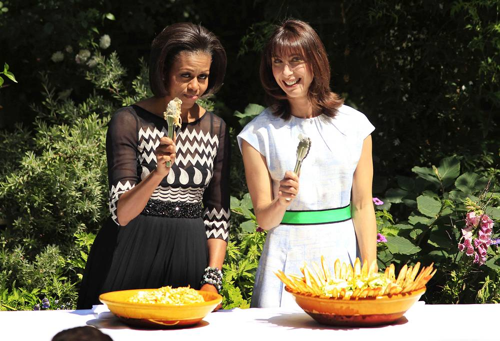 Michelle Obama together with Samantha Cameron, the wife of Britain's Prime Minister David Cameron, served barbecue for British servicemen during a UK visit in 2011