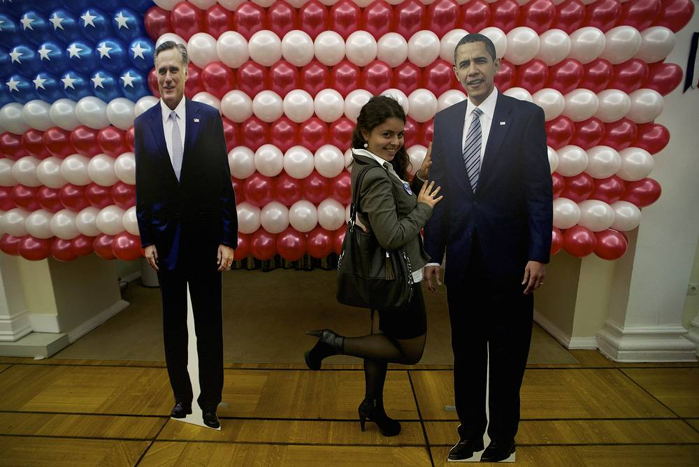 McFaul is a known supporter of the Obama administration. Photo: a guest poses with a cutaway board depicting Barack Obama during the Election Night reception at Michael McFaul's residence