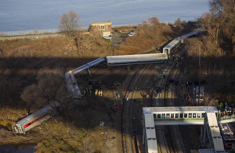 First responders gather around the derailment of a Metro North passenger train in the Bronx borough of New York Dec. 1, 2013