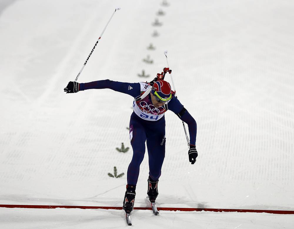 Ole Einar Bjorndalen crosses the finish line at Sochi Olympics 2014