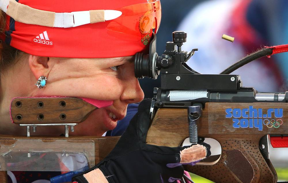 Ekaterina Shumilova of Russia shoots in the women's 10km biathlon pursuit