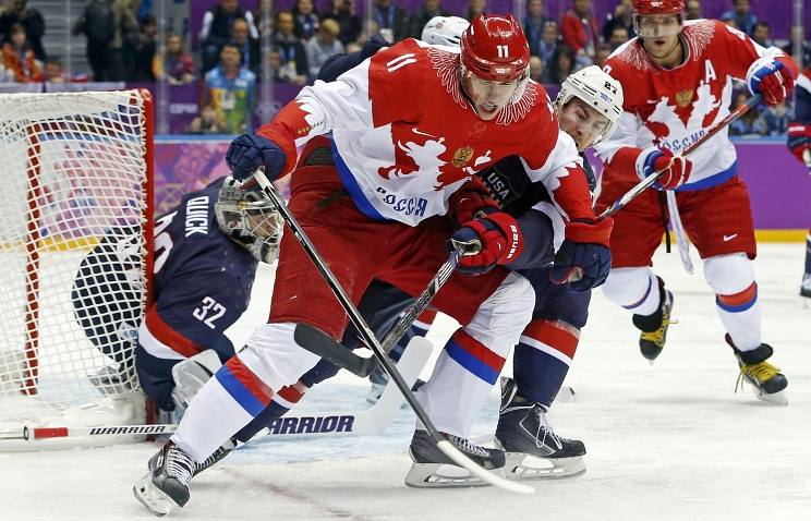 Russia forward Yevgeni Malkin seals off the puck from USA defenseman Ryan McDonagh in the first period