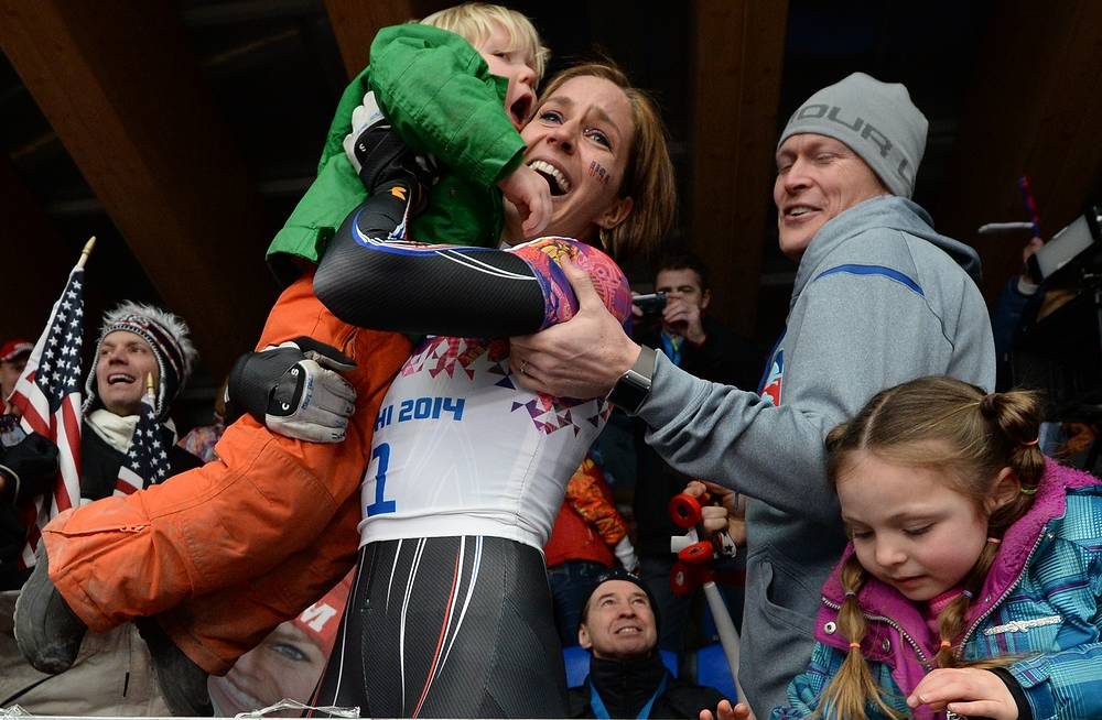Athletes also share happiness with their nearest. Photo: Noelle Pikus-Pace of the USA celebrates with her family, husband Janson Pace son Traycen and daughter Lacee, after winning silver the women's Skeleton competition