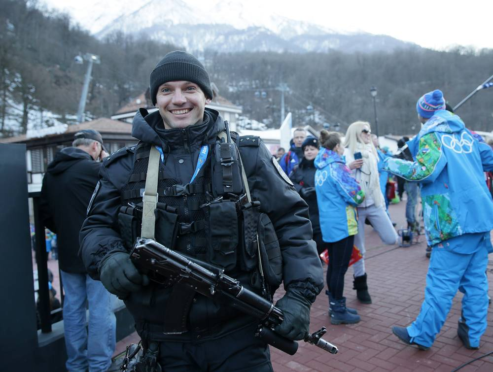A security guard patrols at the Sochi 2014 Olympic Games