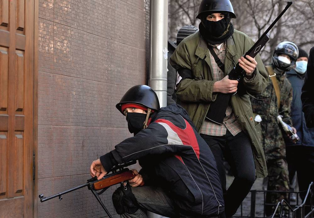 Protesters using air rifles in the clashes with riot police
