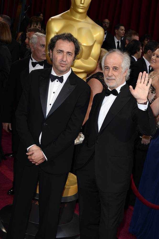 """Paolo Sorrentino (L) won the award for best foreign language film of the year for """"The Great Beauty"""""""