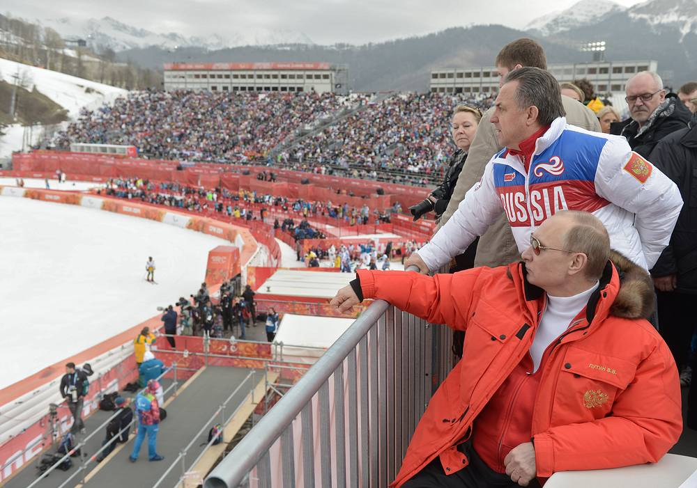 Russian President Vladimir Putin (front) and Russian Sport Minister Vitaly Mutko watch the Men's Super G event