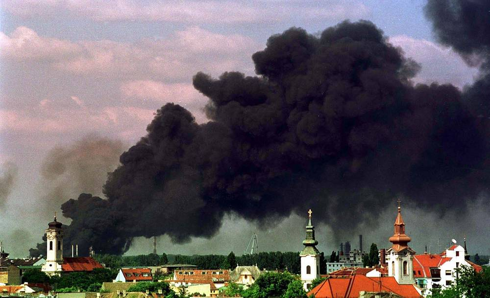 Black smoke rises from a burning oil refinery in Novi Sad