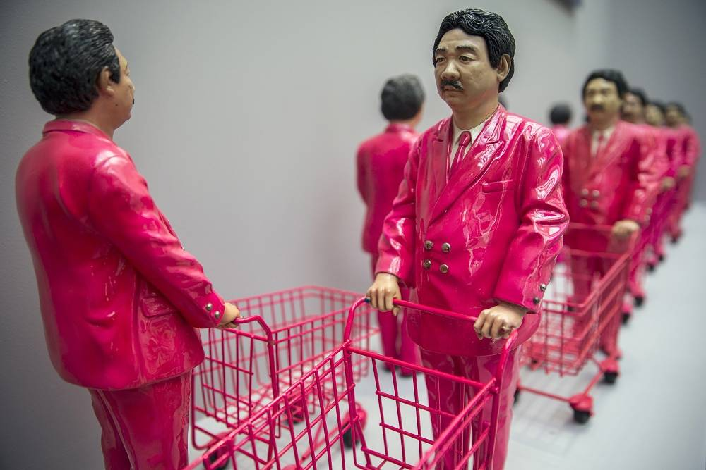 """Composition """"15 pieces of Pink Man: Icon of Consumerism"""" by Thai artist Manit Sriwanichpoom"""