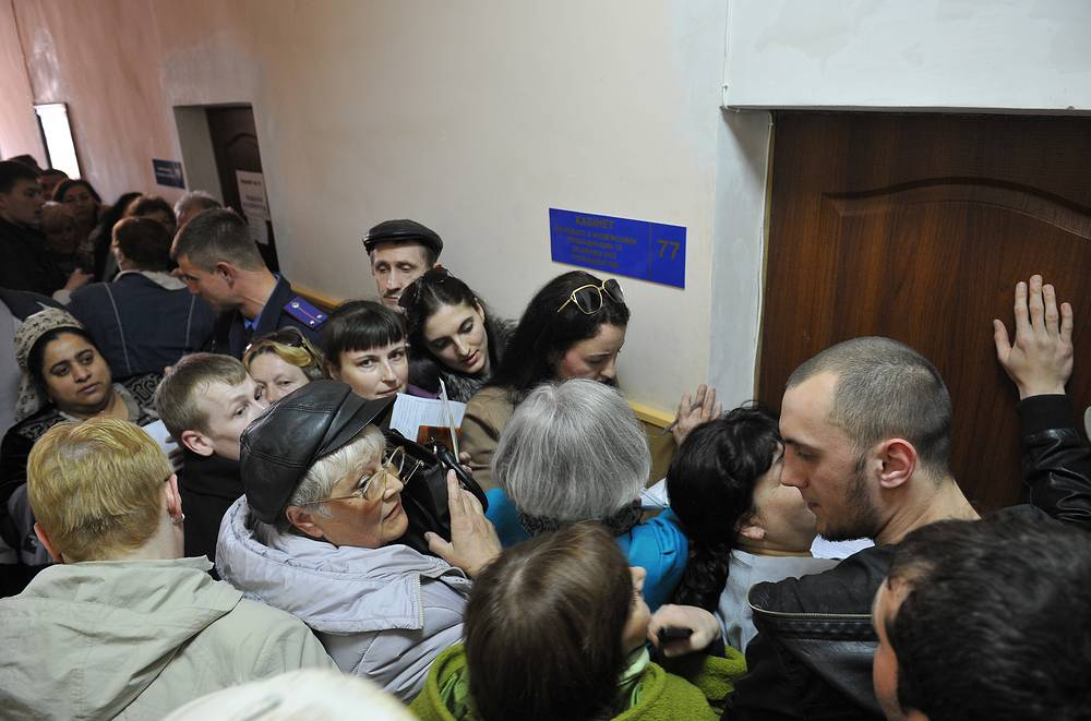 People rushing to apply for Russian citizenship at a migration service office in Crimea