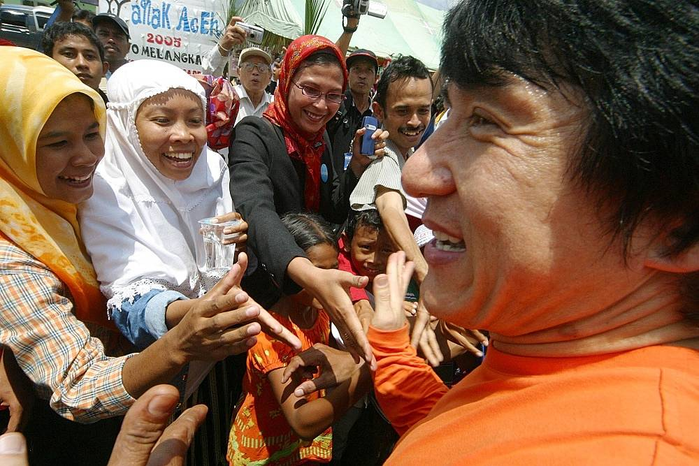 Jackie chan is famous for his charity work. Photo: Chan with refugees that had to flee after a tsunami in Indonesia, 2005