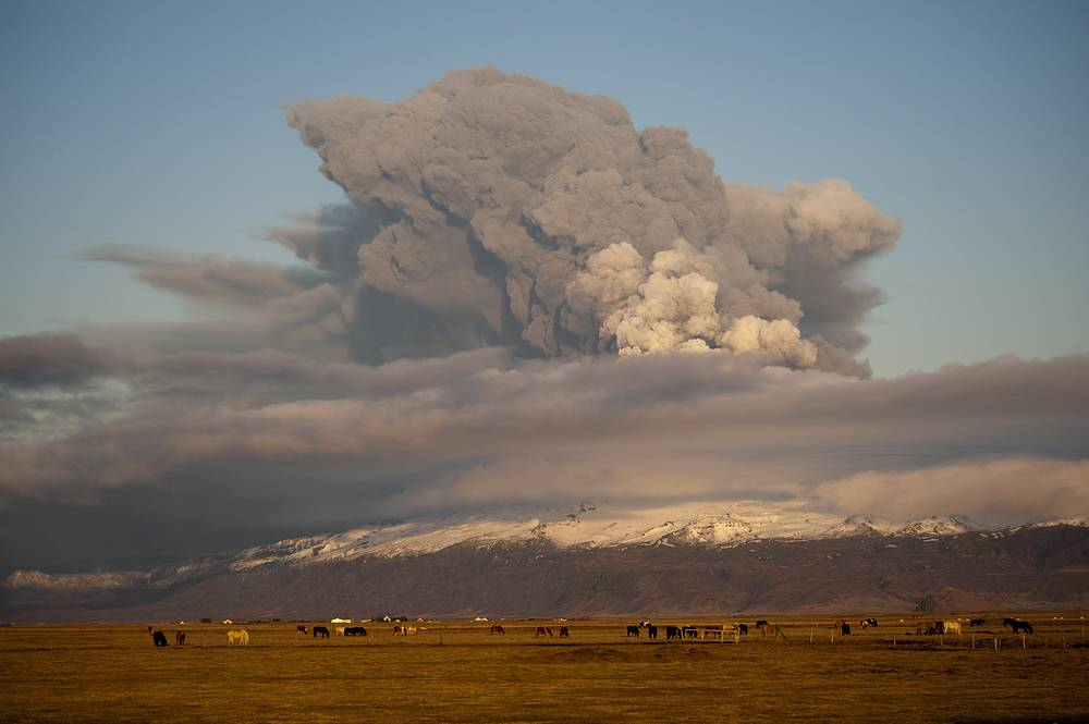 Smoke rises as an eruption occurs