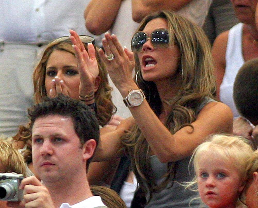 Beckham supports her husband during a World Cup game between England and Portugal