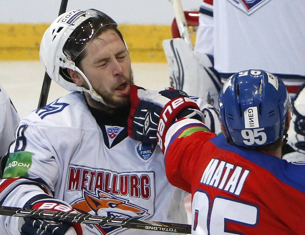 Metallurg's Yaroslav Khabarov getting a punch