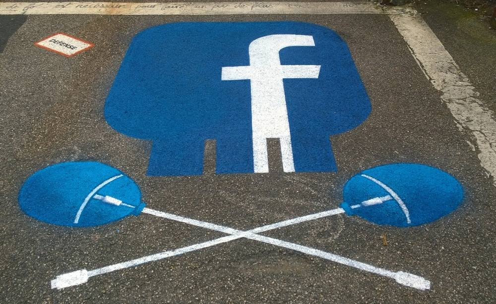 Facebook logo painted on the ground
