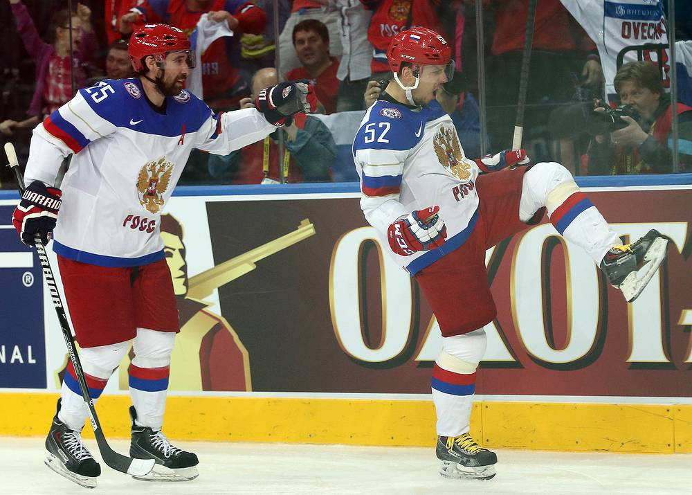 Sergei Shirokov (R) of Russia celebrates with Danis Zaripov (L) after scoring a goal