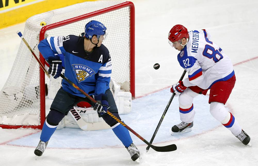 Yevgeni Medvedev (R) of Russia and Jori Lehtera (L) of Finland