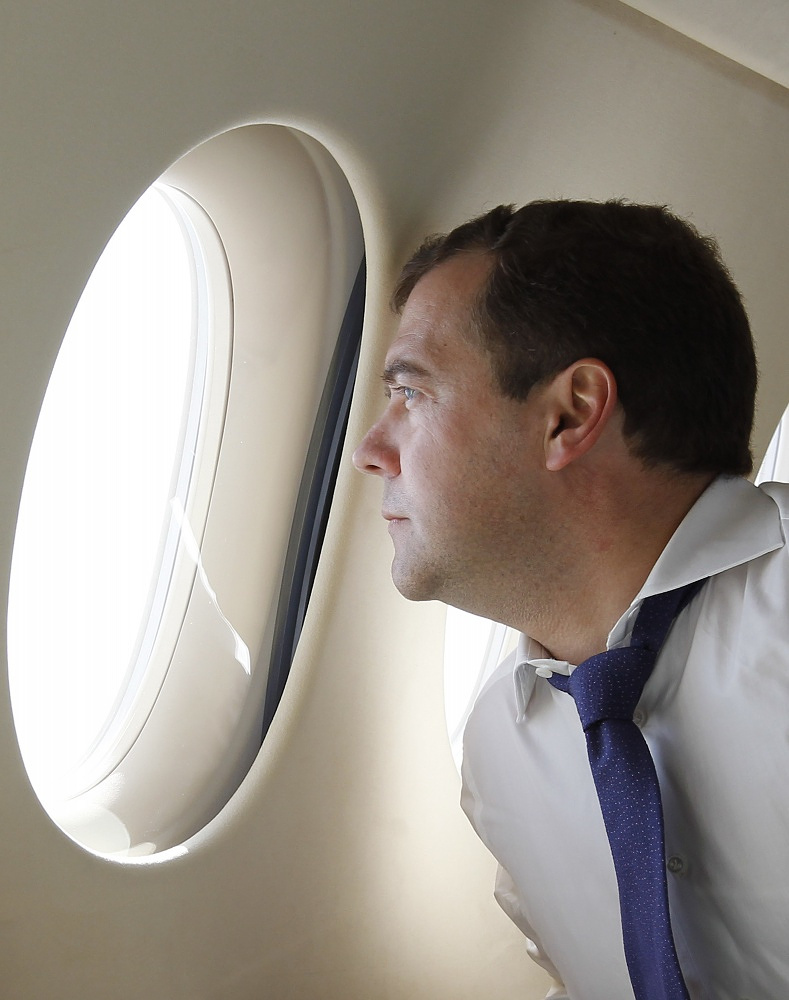 Russia's Prime Minister Dmitry Medvedev on board a plane in 2012