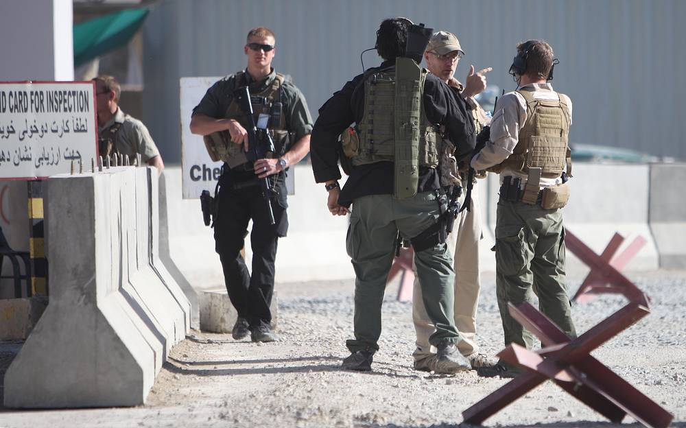 Foreign security officials inspect the scene of a suicide bomb attack in Kabul,