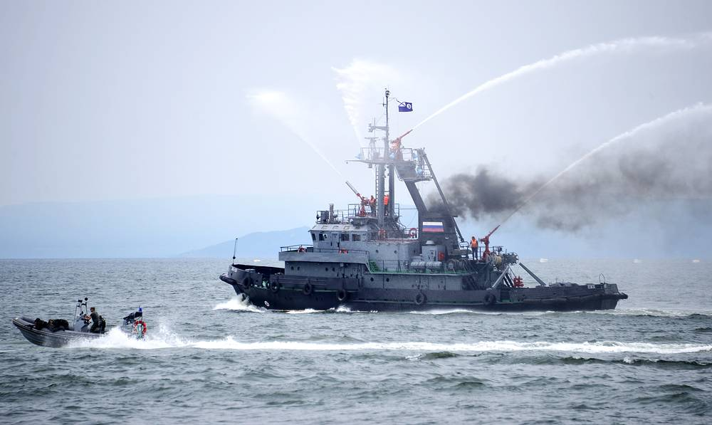 Firefighters battle a simulated fire during Navy Day parade rehearsal in Vladivostok