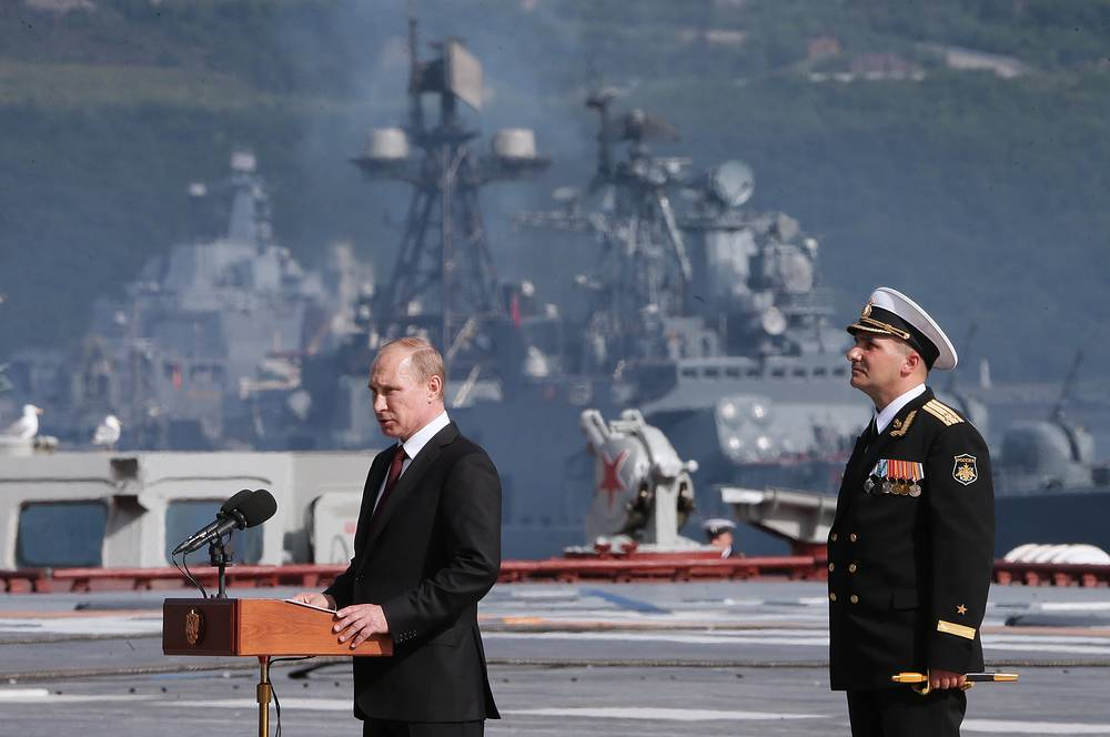 Russia's President Vladimir Putin (L) speaks during  the Russian Navy Day parade in Severomorsk