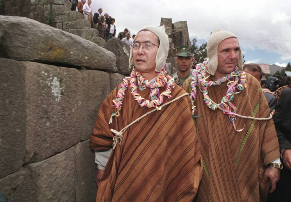 Former Peruvian president Alberto Fujimori, left, and Ecuadorean President Abdala Bucaram wear traditional dress of the Ayacucho region of Peru