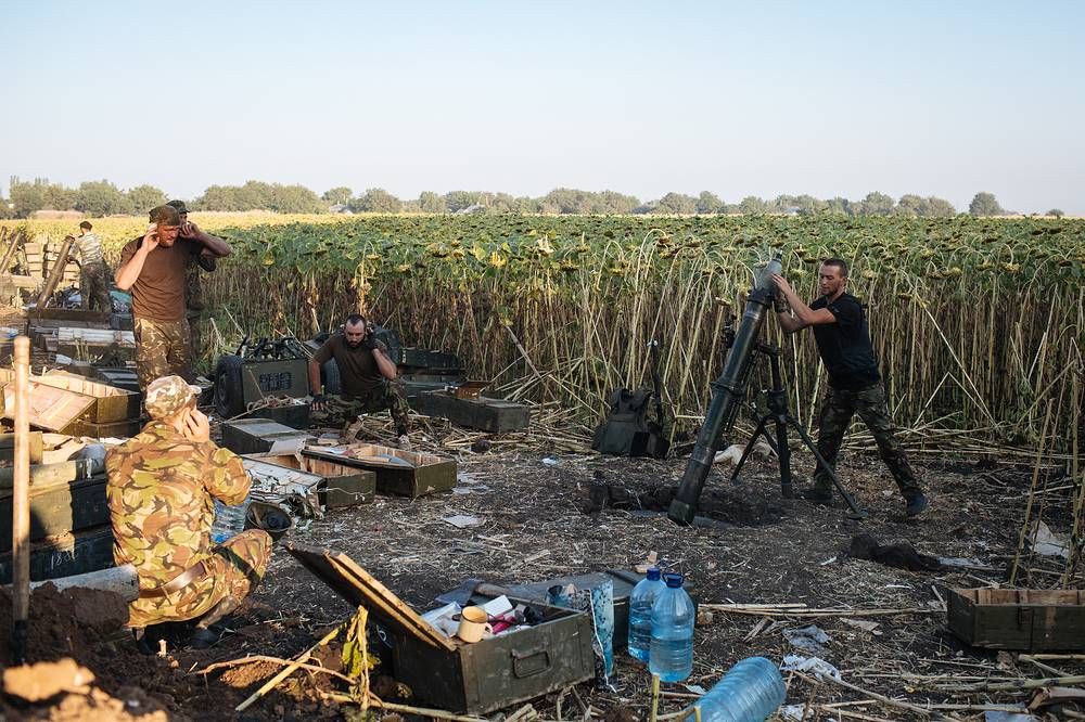 A Ukrainian soldier loads a mortar during a battle against militia not far from Donetsk
