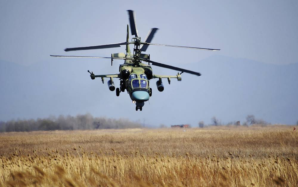 """Kamov Ka-52 """"Alligator"""" attack helicopter. The machine has a distinctive coaxial rotor system of the Kamov design bureau"""