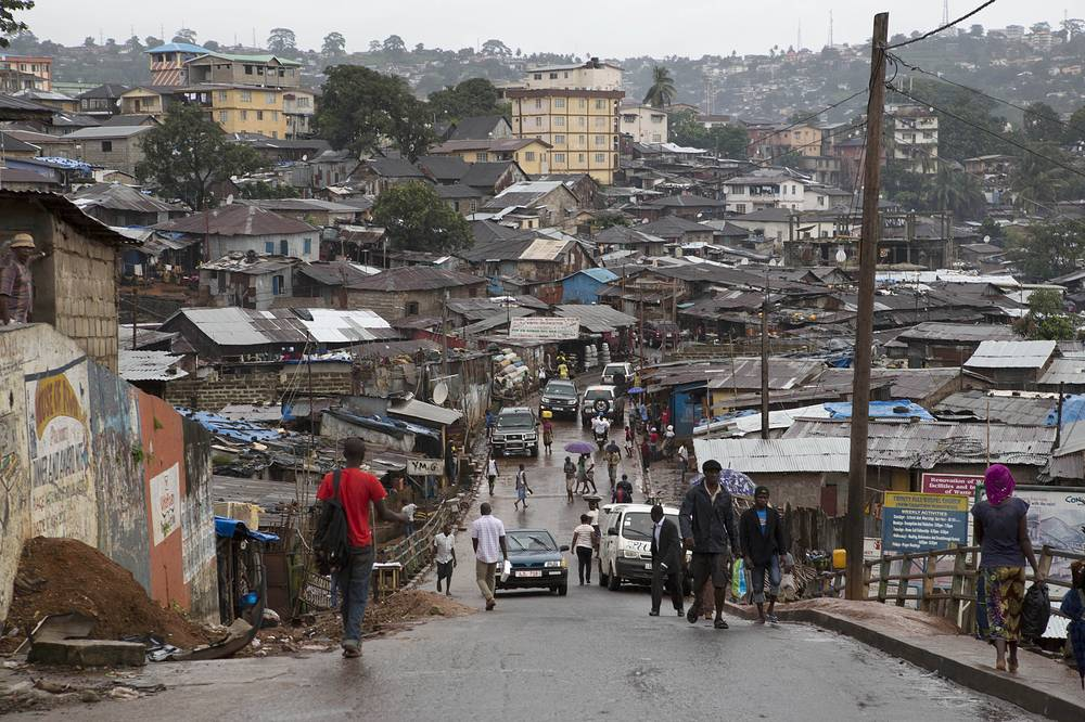 The outbreak started in West Africa in December 2013 and by now Ebola has spread across five countries, namely Guinea, Liberia, Sierra Leone, Nigeria, and Senegal. Photo: People buy last minute provisions as they prepare for a nationwide three-day curfew in Freetown, Sierra Leone, 18 September 2014