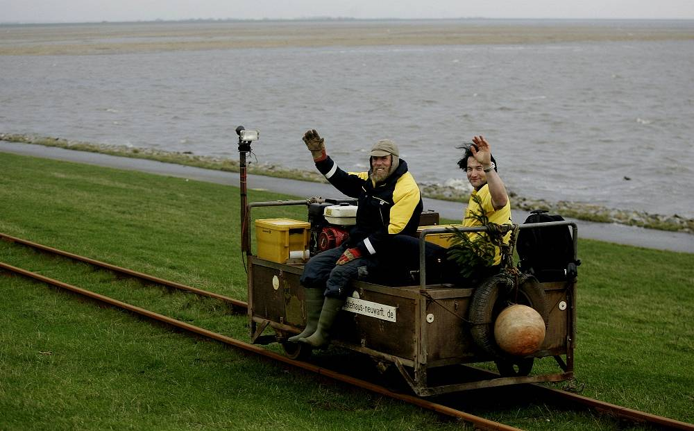 Photo: Germany's postmen ride a dump truck near Dagebuell at the North Sea, northern Germany, December 5, 2006