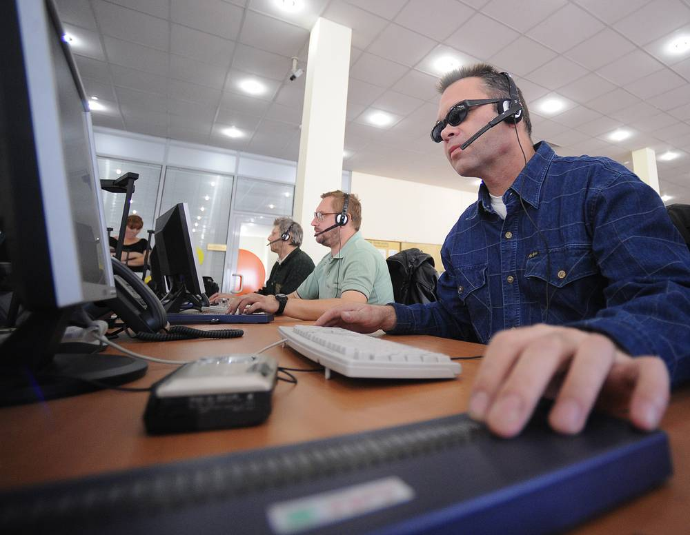 Photo: Visually impaired people work at call centre, September 6, 2010