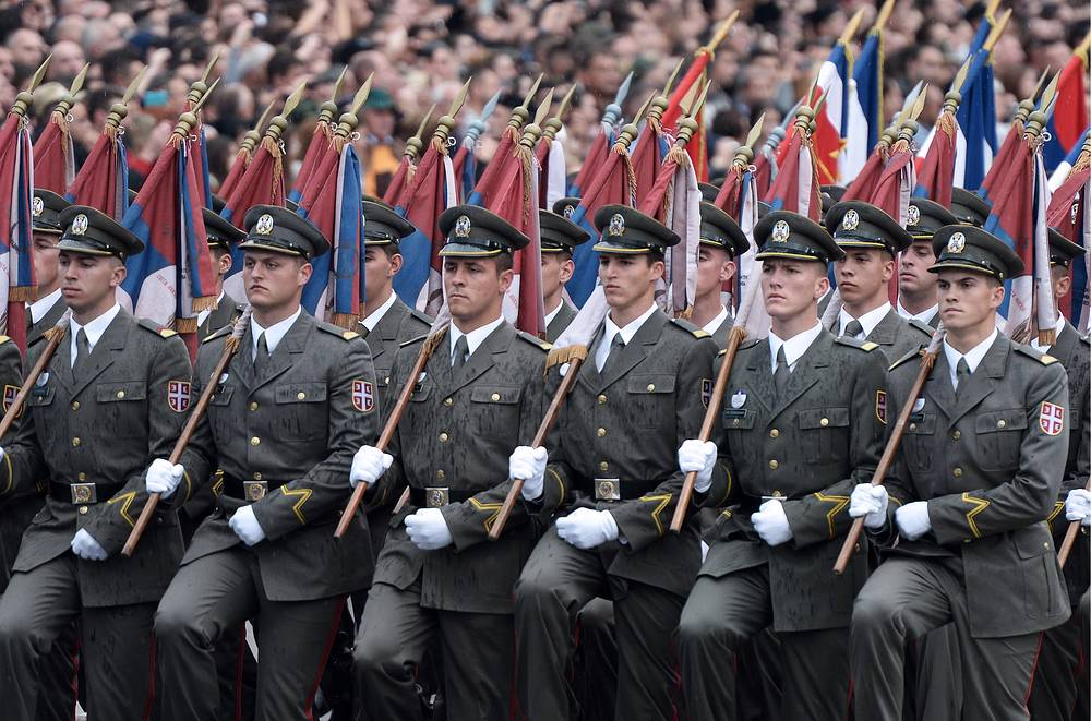 Serbian infantrymen participate in a military parade marking the 70th anniversary of Belgrade's liberation from Nazi German occupation, 16 October 2014
