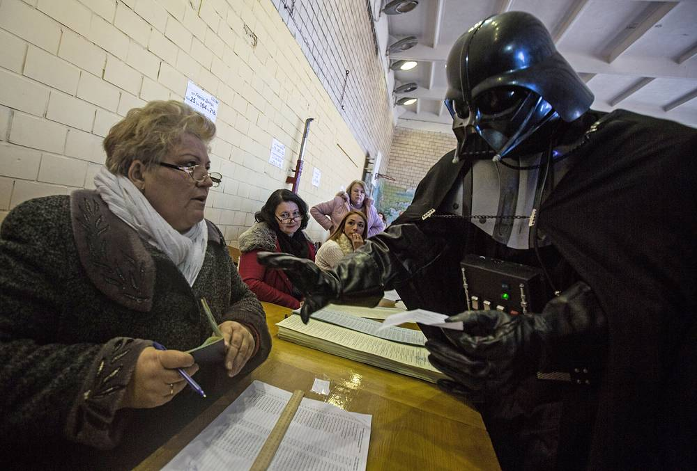 Darth Vader, the leader of the Internet Party of Ukraine, dressed as a character from Star Wars, votes at a polling station during early elections for a new parliament