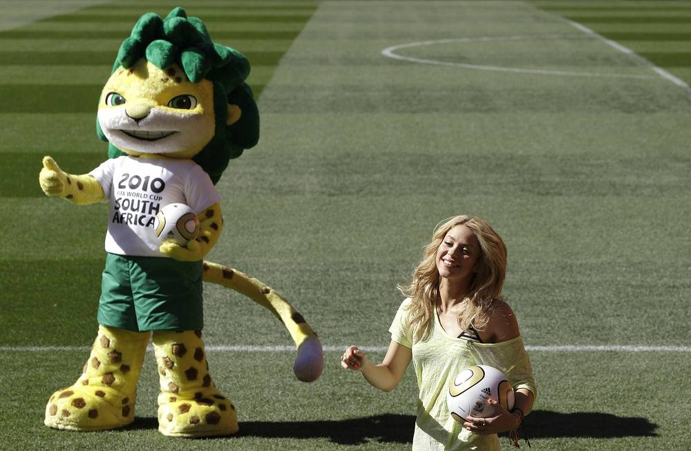 Photo: Colombia's singer Shakira poses with the World Cup 2010 mascot Zakumi in Johannesburg, South Africa, July 10, 2010