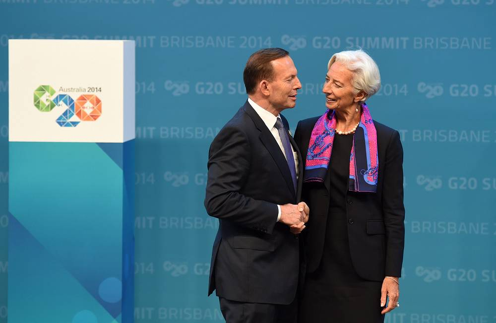 Photo: Australian Prime minister Tony Abbot greets the managing director of the IMF Christine Lagarde during the official welcome at the Brisbane Convention and Exhibitions Centre